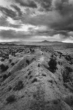 John Loengard, Georgia O'Keeffe on evening walk with her dogs, Ghost Ranch, New Mexico 1966