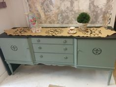 Lovely vintage sideboard painted in Autentico Chalk Paint troubled water with the top and stencil done in nearly black.  Come join us for one of our workshops to learn how, or contact us to paint one for you.  Lots of vintage items on our website too. www.craftynest.co.uk