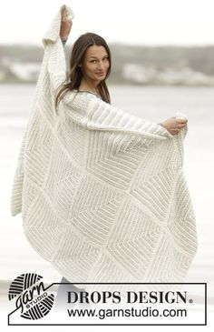 "Set consists of: Knitted DROPS blanket and pillow with domino squares in ""Cloud"". ~ DROPS Design"