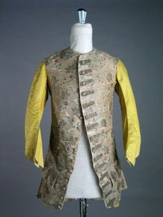 Long-sleeved waistcoat, 1750-1760. Silver silk brocaded with floral motifs.