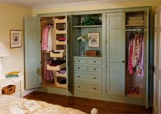 instead of a joint closet, 2 closets with a dresser & shelves in between