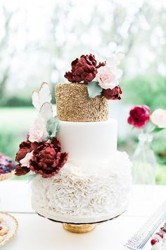 glamorous marsala and gold wedding cake