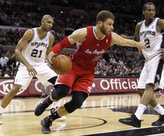 Los Angeles Clippers forward Blake Griffin (C) controls a rebound as San Antonio Spurs center Tim Duncan (L) and forward Kawhi Leonard stand nearby during the first half of their NBA Western Conference semi-final playoff basketball game in San Antonio, Texas May 15, 2012.