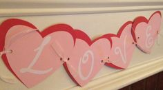 This banner would be perfect for Valentines Day photos! This is a handmade banner using cardstock, vinyl lettering, and ribbon for fasteners. This banner has two layers to each part (red hearts are 5 1/2 inch and pink hearts are 5 inch). The lettering is acid-free adhesive vinyl. All of my items can be customized according to theme, color, and interest. When ordering a custom banner, you can choose the following: -size of pieces -color (paper, ribbon, lettering) -Lettering (vinyl or card...
