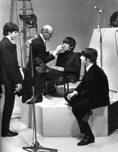George Harrison getting makeup for A Hard Day's Night, 1964.