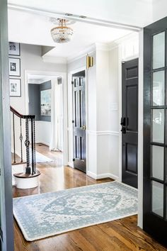 A foyer gets a classic, timeless yet modern update using a blend of traditional style thrifted furnishings with clean lines and a neutral color palette.