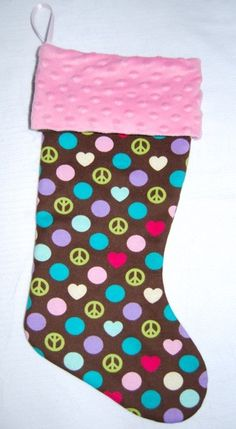 christmas stocking.  Peace and Love Christmas StockingPink or by cyndilooboutique, $20.00