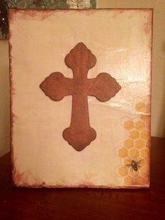 Canvas Cross. I Mod Podged scrapbook paper on the canvas, painted the cross, tacky glued the cross, and painted the edges for effect.