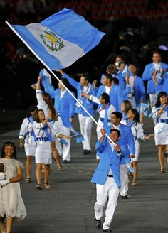 Guatemala's flag bearer Juan Ignacio Maegli holds the national flag as he leads the contingent in the athletes parade during the opening ceremony of the London 2012 Olympic Games at the Olympic Stadium July 27, 2012.