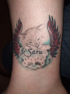 our Sara cat tattoo