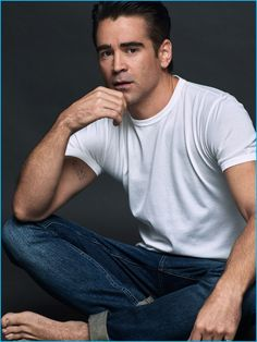 Colin Farrell goes casually classic in a white tee and dark rinse denim jeans.