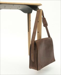 This Bistro Table Was Designed With Dedicated Spaces To Hang Your Bag | CONTEMPORIST