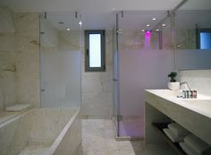 Spacious marble bathrooms with shower and / or bathtub.