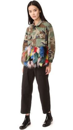 A wide band of plush fox fur details the hem of this camouflage Harvey Faircloth army jacket. Covered buttons secure the breast pockets and placket. Long sleeves with elastic cuffs. Unlined.