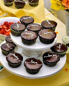 baby shower chocolate cupcakes with the words baby love on them all... LOVE :)
