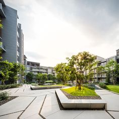 The Valley | Sansiri - trees & grass make even the starkest buildings come to life! www.architectlarryladelfa.com