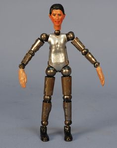 SWISS BUCHERER JOINTED STEEL DOLL, 1920's. Patented steel body doll with composition male head, hands and boots, (no clothing). Height 8 inches. Old Dolls, Composition, Wonder Woman, Hands, Steel, Superhero, Boots, Clothing, Leather