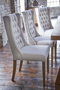 Upholstered dining room chairs with wooden table and white leather