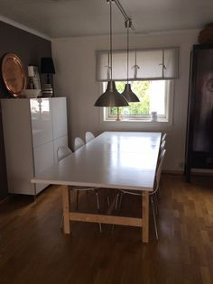 Norden table from IKEA. Top painted glossy white.