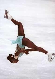 Surya Bonaly the only woman to do a back flip and the only person to do it landing on one foot.