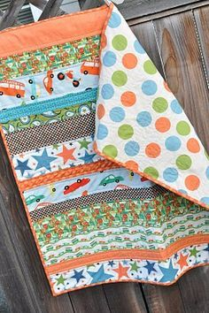 """And the other was a simple strip quilt, made out of the leftovers from this quilt. It took me only a few minutes to sew the strips together, and less than an hour to quilt it in straight lines, which was done by sewing a line about 1/2"""" on either side of each seam. Easy! The binding was what took the longest!"""