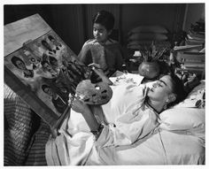 .. 								 					Frida Kahlo painting while confined to her bed. Source: http://passportto.iberostar.com/2012/12/...
