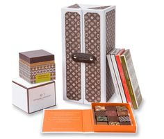 Designer Chocolate  Glance at this picture and you might be forgiven for thinking that Louis Vuitton has decided to forsake fashion and set up shop as a chocolatier...    It's actually the best-selling Monogrammed Gift Box by artisan du Chocolat. Liquid-centre salted caramel truffles, candied orange peels and creamy bars are all perfectly arranged inside this trunk-like box – the perfect gift for a discerning mum on 18th March.    Visit GiftVault.com