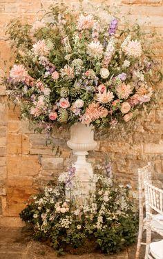 Giant Pink Floral Arrangement | Almonry Barn South West Wedding Venue | Romantic Wedding Decor | Pink Colour Scheme | Penoy & Rose Floral Displays | Cake Table | Naomi Kenton Photography | http://www.rockmywedding.co.uk/louise-paul