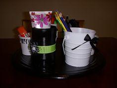 Turn a lazy susan and cans/pails into supply holders