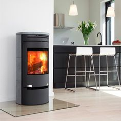 Aduro 1-1SK with Drawer - Black Soapstone - Aduro 1 can also be supplied clad in Finnish soapstone tiles on the sides and the top. Soapstone is a unique natural product, one of its features is that it is able to store heat and release it over a longer period. Aduro 1 is a modern convection wood burning stove that is characterised by its clean lines and timeless appearance.