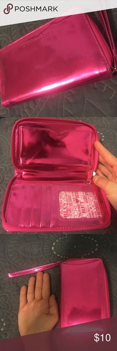 Victoria's Secret clutch Metallic pink. Never used. Places to hold money, cards, change and your phone! Victoria's Secret Bags