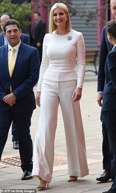 Style star: The first daughter's outfit featured wide-legged pants and a form-fl. - Style star: The first daughter's outfit featured wide-legged pants and a form-flattering shirt th -