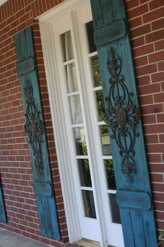 """The European look - Faux wrought iron shutters. Two 14"""" x ..."""