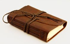 Leather bound journal.   http://tomtaylorbuckles.com/large-journal.html