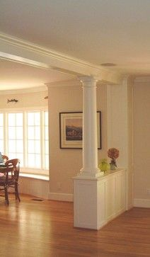 Half wall with pillar with built in bookshelf on dining room side. We could do this at the front door maybe.