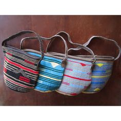A selection of our limited edition Mayim Bags. Handcrafted by our artisan partners in Kenya. Finished with a plaited strap made from beautiful, premium quality leather.