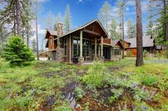 Mountain cabin home wood exterior with forest and flowers  Stock Photo