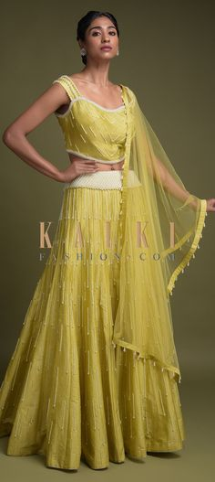 Buy Online from the link below. We ship worldwide (Free Shipping over US$100)  Click Anywhere to Tag Lime Green Lehenga And Crop Top In Silk Embellished With Pearls Online - Kalki Fashion Lime green lehenga and crop top in silk.Embellished with pearls and cut dana work in striped pattern.