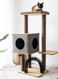Clean, simple, and convenient for cats of all ages, this modern cat tower condo covers most of the essential needs for your kitty - sleep, fun, and self-care. Cat Towers, Condo, Sleep, Kitty, Cats, Simple, Modern, Fun, Little Kitty