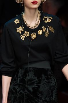 Great wearable presentation of multiple gorgeous vintage brooches!  New Trend!! Dolce & Gabbana Fall 2015
