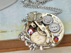 steampunk necklace - LOVE TAKES TIME - antique silver tone  vintage pocket watch movement necklace with Iris and Swarovski rhinestones. $89.50, via Etsy.