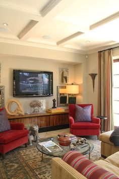 Red Accented Living Room Layout With Credenza And Wall Mounted Tv