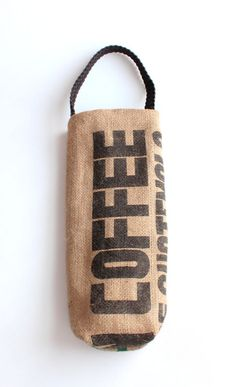 Coffee Sack Wine Tote Carry your favorite bottle of wine in this one-of-a-kind, upcycled coffee sack wine tote. This bag is created from castoffs. From a coffee bean roaster on Cleveland's west side, (Bottle Design Flour Sacks) Burlap Coffee Bags, Coffee Bean Bags, Burlap Tote, Coffee Sacks, Burlap Sacks, Burlap Fabric, Sack Bag, Burlap Crafts, Wine Tote