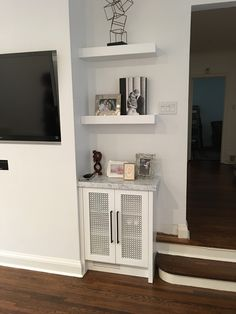 Small Built in and floating shelves above. Built by Watchtower Interiors Inc. Built In Wall Units, Wall Unit Designs, Toronto Island, Built Ins, Four Square, Floating Shelves, The Unit, Interiors, Built In Furniture