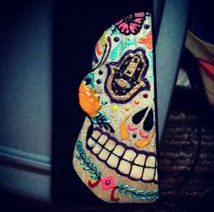 Sugar skull with the hand of hamsa paddle!