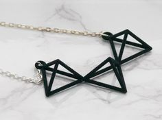 Consist of 3 tetrahedrons -Create simple and smart looking    The necklace chain is not included. To purchase the pendant with a chain, please add a