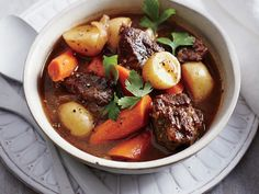 Classic Slow Cooker Beef Stew | A nutty dark beer adds richness and depth to the stew. Be careful not to choose a beer that's super-hoppy; it will taste too bitter. To get 2 pounds of trimmed meat, you'll probably need to purchase a 2 1/2-pound roast.