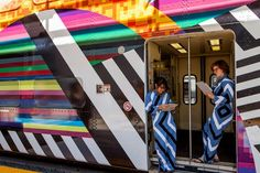 The exterior of the train car has been vinyl-wrapped with a brightly coloured abstract image, designed by Marman and Borins, while the interior has been decorated with similar posters and ceiling vinyl.