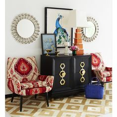 Bohemian Glamour. Layer your lair luxe. Jonathan Adler's new Turner Cabinet looks fab flanked by our Mrs. Godfrey Chairs in a bold ikat velvet. Symmetrical Jack Mirrors and a majestic Jenna Snyder-Phillips painting crown the classical composition.
