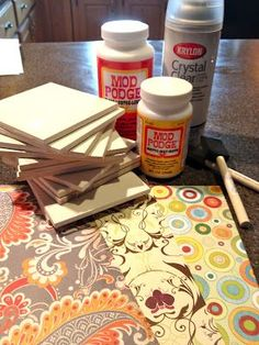 Mod podge coaster tutorial. I like the scrapbook paper tip but I'm thinking more comic books